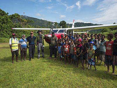 Just landed at the Nikse Village airstrip. Sepik Province, PNG - photography by Hans Kemp