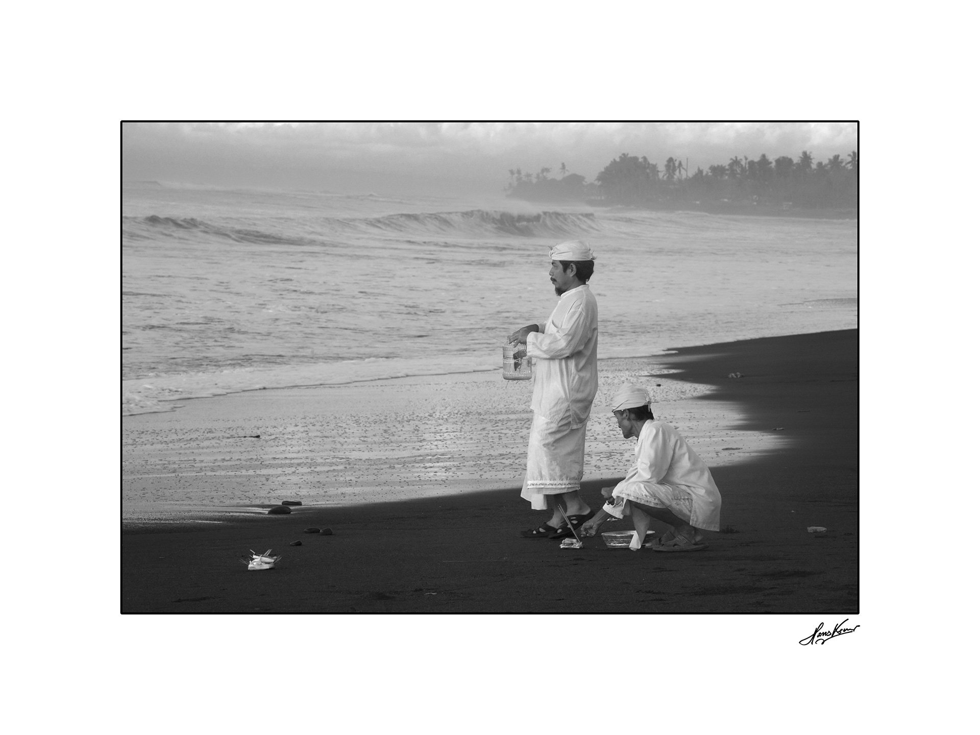 Priests praying on Purnami Beach in Bali, 2009