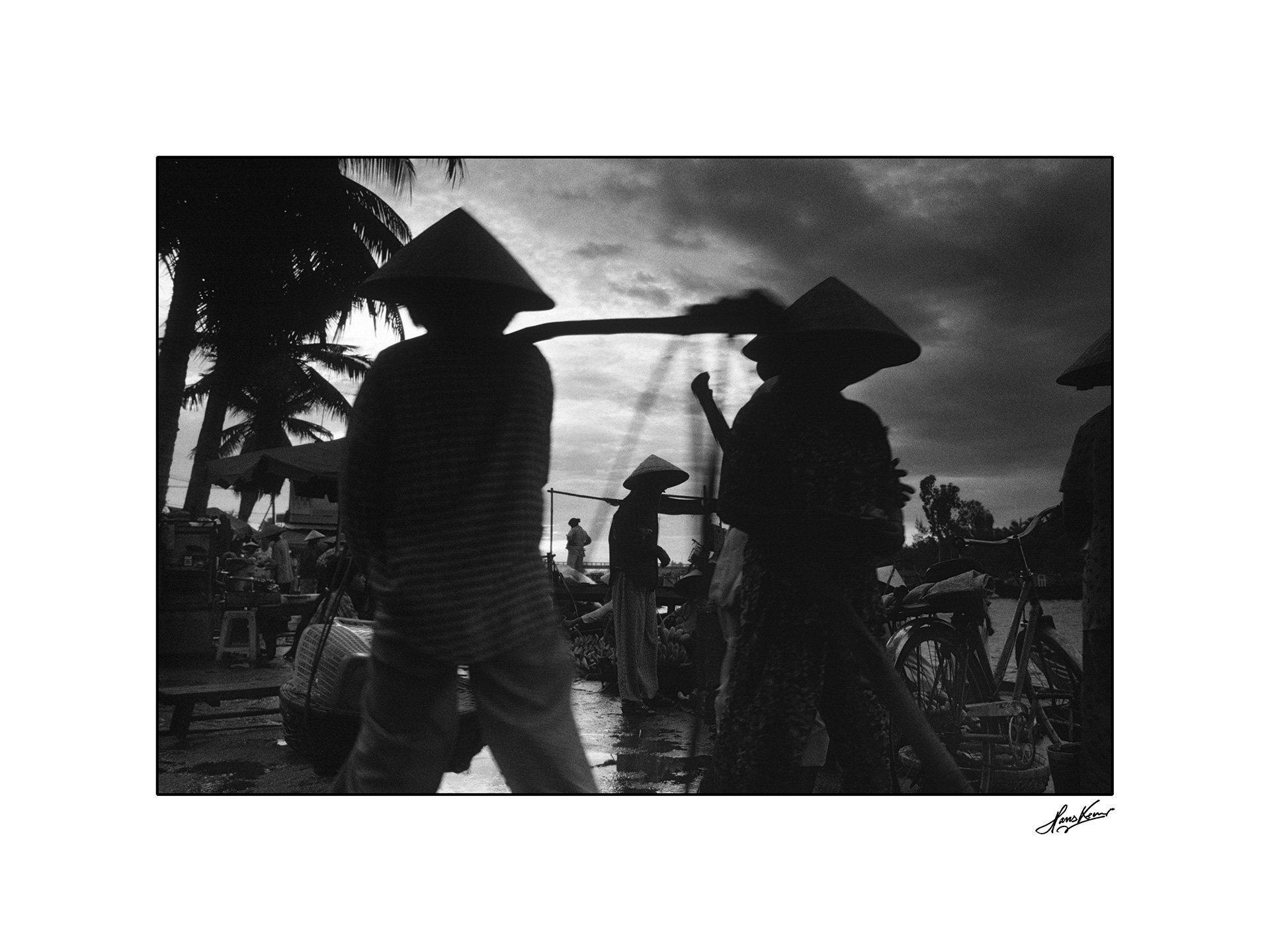Vendor silhouettes, Hoi An, Vietnam, 1999