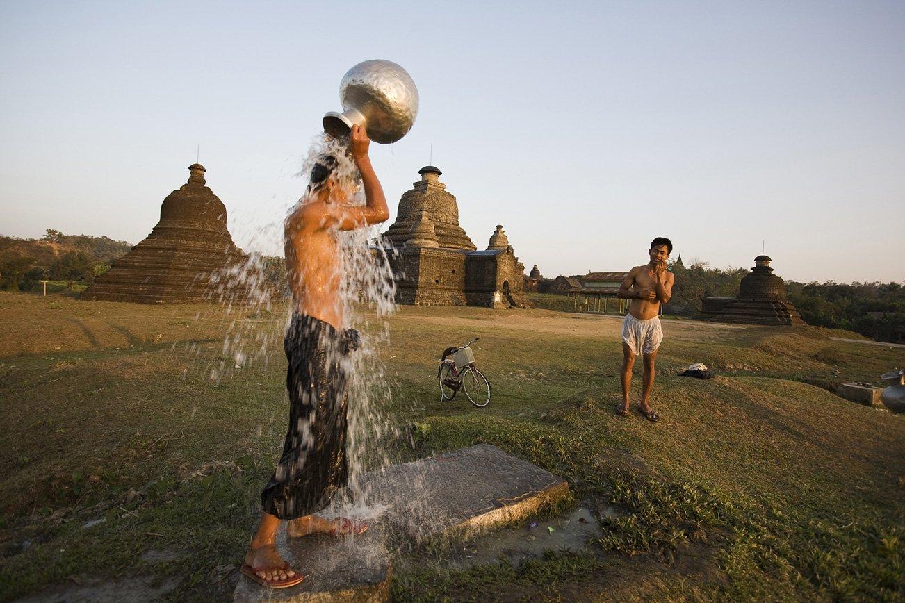 Having a bath amidst centuries old pagodas.