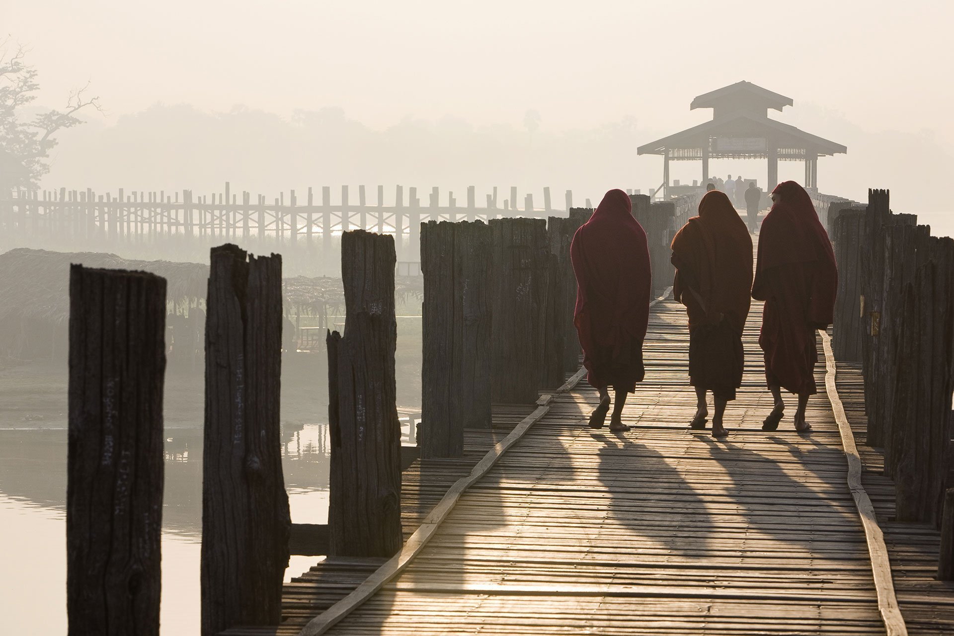 Monks on the Ubein Bridge near Mandalay, Myanmar, 2012 - Photography by Hans Kemp