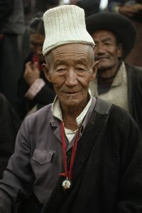 A tibetan man with a picture of the Dalai Lama, Lhasa, Tibet, 1990