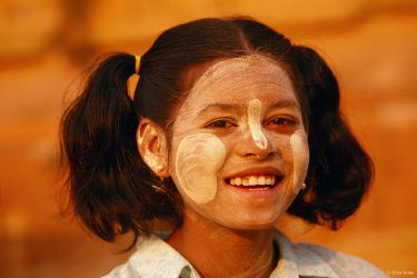 Girl with her face covered in thanaka paste to cool and protect her skin, Bagan, Myanmar, 2001