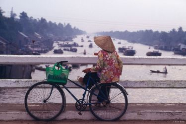 Woman on a bridge in the Mekong Delta, Phung Hiep, Vietnam1994