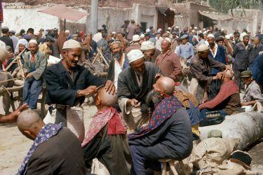 Barbers at the sunday market, Kashgar, China, 1988